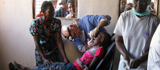 Dr. Murphy working with children