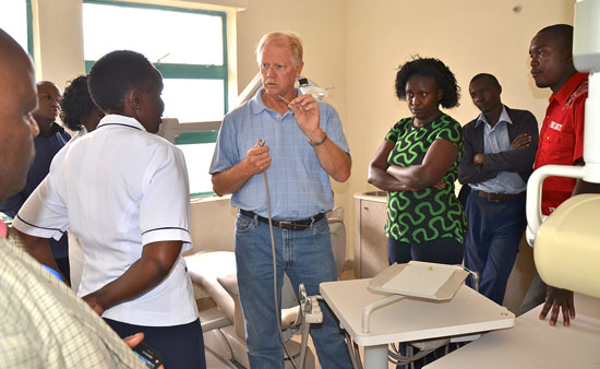 assisting Kenyan children with learning about dental health